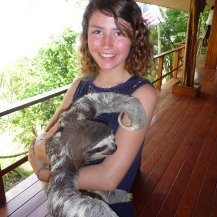 Mia with Dooger, the three toed sloth